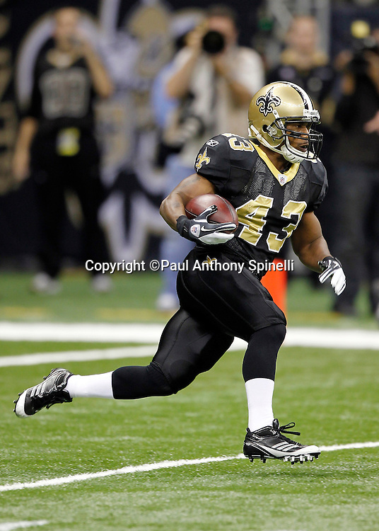 New Orleans Saints kick returner Darren Sproles (43) returns a kick during the NFL wildcard playoff football game against the Detroit Lions on Saturday, January 7, 2012 in New Orleans, Louisiana. The Saints won the game 45-28. ©Paul Anthony Spinelli