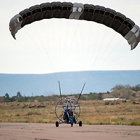 070913  Adron Gardner/Independent<br /> <br /> Cibola County Sheriff John Valdez lands a Silver Lining Aviation powered parachute at the Grants-Milan Municipal Airport Tuesday.