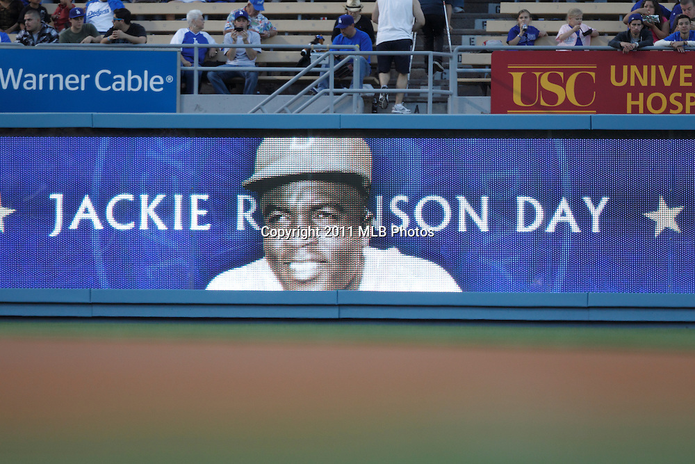 LOS ANGELES, CA - APRIL 15:  A sign featuring Jackie Robinson and Jackie Robinson Day appears on the left field wall during the game between the St. Louis Cardinals and the Los Angeles Dodgers on Friday April 15, 2011 at Dodger Stadium in Los Angeles, California. (Photo by Paul Spinelli/MLB Photos via Getty Images)