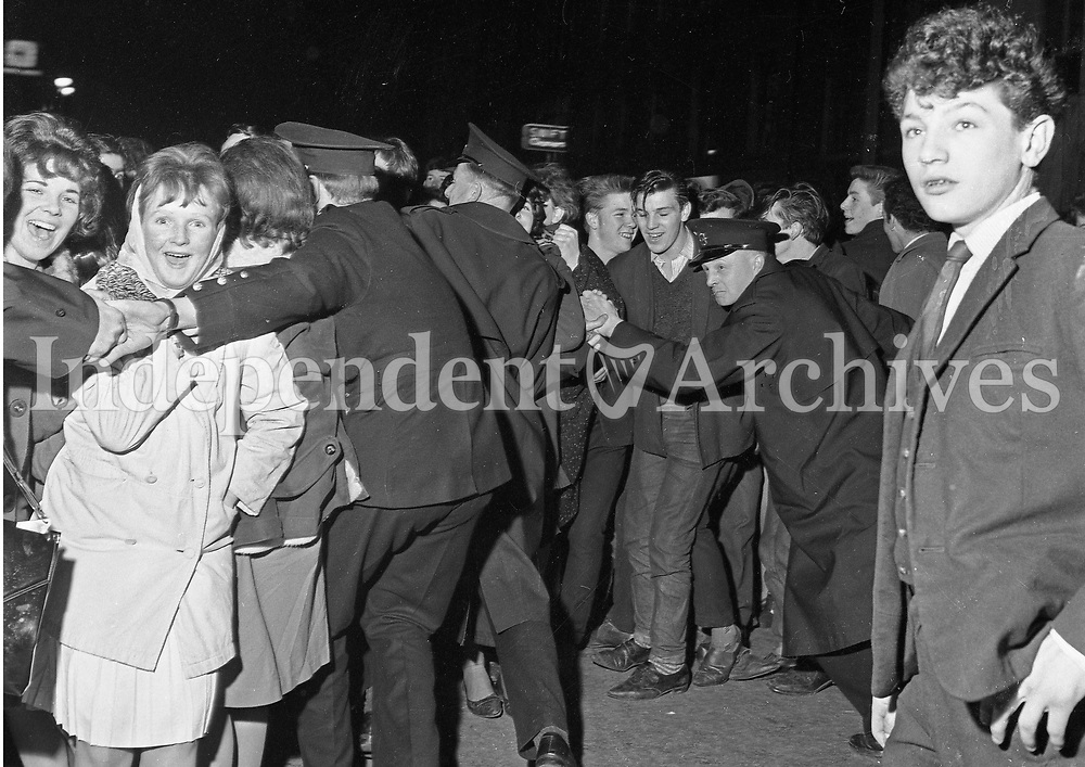 Gardai work to keep the crowds in check at the Beatles concert at the Adelphi Theatre in Dublin, November 7 1963.<br />