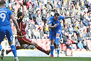 Peterborough United forward Lee Tomlin (29) shoots during the EFL Sky Bet League 1 match between Bradford City and Peterborough United at the Northern Commercials Stadium, Bradford, England on 9 March 2019.
