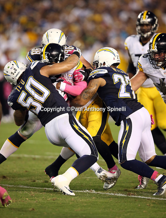 Pittsburgh Steelers running back Le'Veon Bell (26) gets gang tackled by San Diego Chargers inside linebacker Manti Te'o (50) and San Diego Chargers strong safety Jimmy Wilson (27) as he runs the ball in the second quarter during the 2015 NFL week 5 regular season football game against the San Diego Chargers on Monday, Oct. 12, 2015 in San Diego. The Steelers won the game 24-20. (©Paul Anthony Spinelli)
