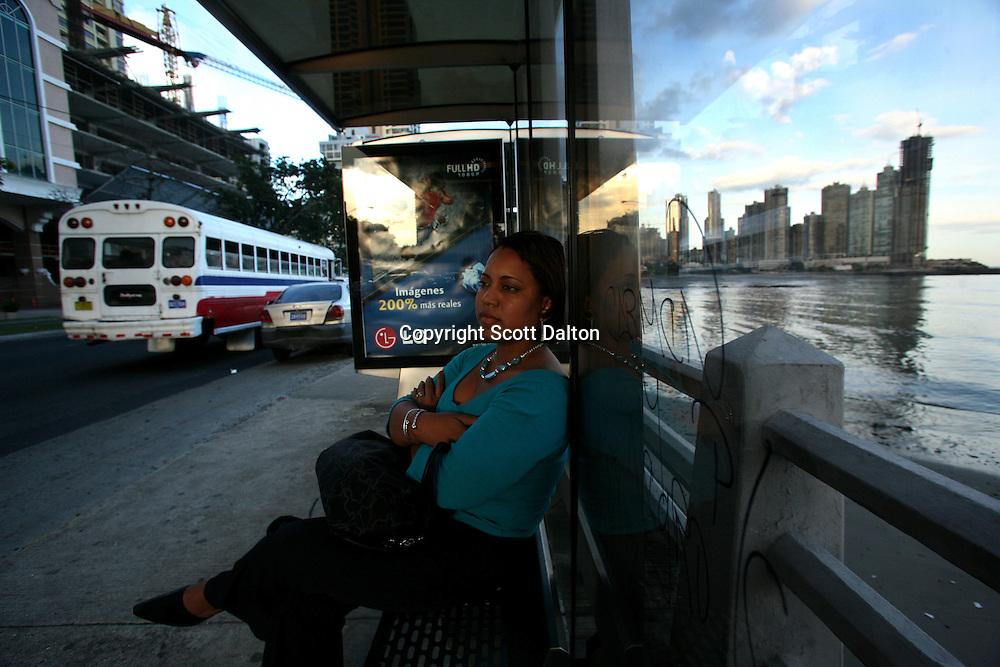A woman waits for a bus in Panama City, Panama on Thursday, September 6, 2007. (Photo/Scott Dalton).