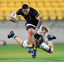 Wellington's Alex Fidow slips the tackle of Northland's Matt Matich in the Mitre 10 Semi Final Rugby match at Westpac Stadium, Wellington, New Zealand, Friday, October 20, 2017. Credit:SNPA / Ross Setford  **NO ARCHIVING**