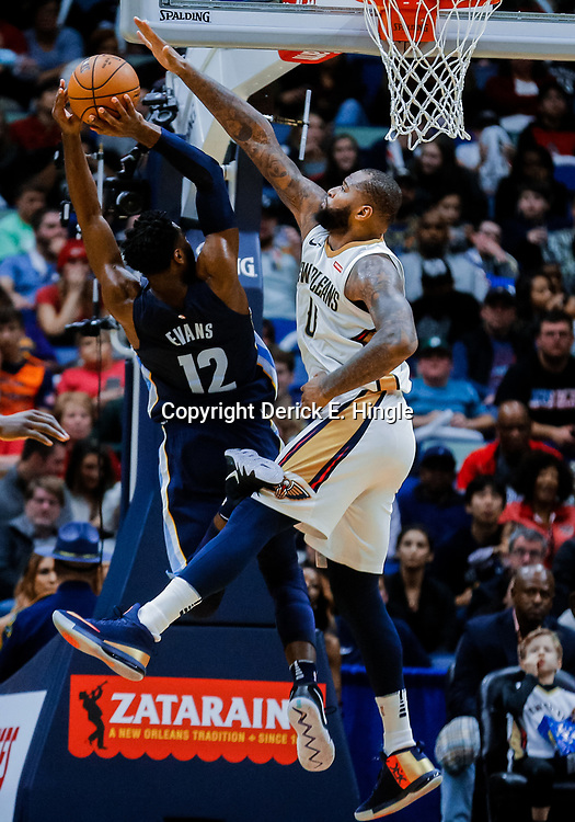 Jan 20, 2018; New Orleans, LA, USA; Memphis Grizzlies guard Tyreke Evans (12) shoots over New Orleans Pelicans center DeMarcus Cousins (0) during the second half at the Smoothie King Center. The Pelicans defeated the Grizzlies 111-104. Mandatory Credit: Derick E. Hingle-USA TODAY Sports