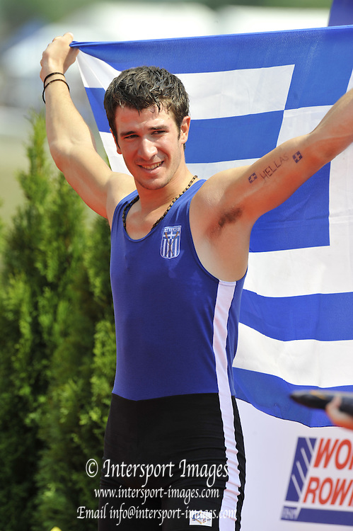 Racice, CZECH REPUBLIC.  Silver medalist GRE JM1X Dionysios ANGELPOPOULOS, raise the flag on the awards dock.  2010 FISA Junior World Rowing Championships. Sunday,  08/08/2010.  [Mandatory Credit Peter Spurrier/ Intersport Images]  tattoo on inside arm