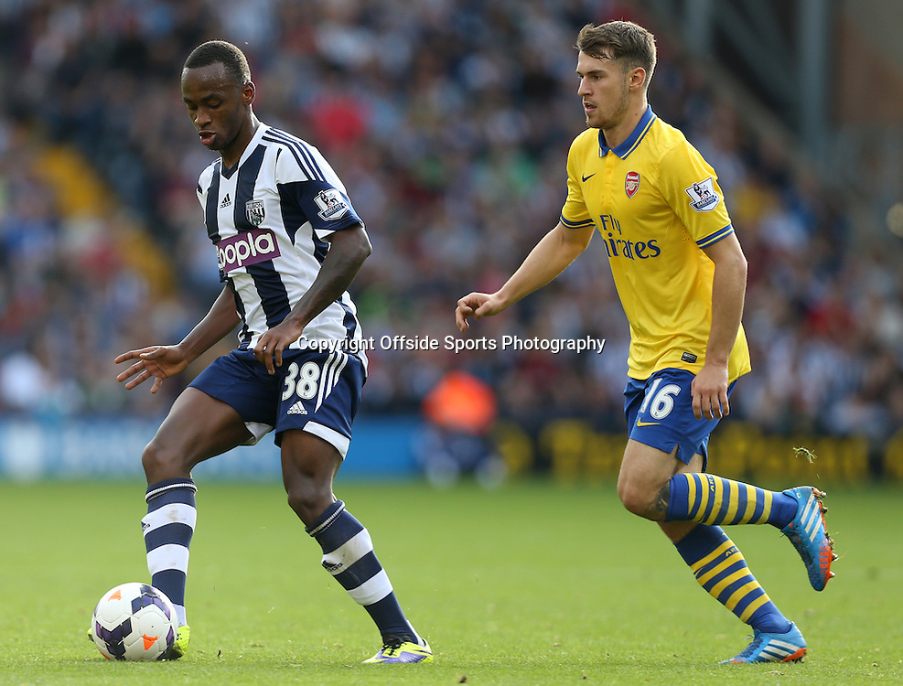 6th October 2013 - Barclays Premier League - West Bromwich Albion v Arsenal - Saido Berahino of West Brom battles with Aaron Ramsey of Arsenal - Photo: Simon Stacpoole / Offside.