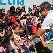 August 19, 2014, New Haven, CT:<br /> Kids answer questions during the Latino Day tennis clinic on day five of the 2014 Connecticut Open at the Yale University Tennis Center in New Haven, Connecticut Tuesday, August 19, 2014.<br /> (Photo by Billie Weiss/Connecticut Open)