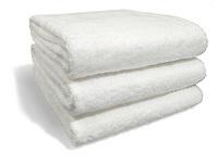 folded clean white bath towels