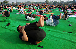 June 17, 2017 - Allahabad, Uttar Pradesh, India - Allahabad: People perform Yoga ahead of International Yoga day celebration at Parade Ground in Allahabad on 17-06-2017. International Day of Yoga, or commonly and unofficially referred to as Yoga Day, is celebrated annually on 21 June since its inception in 2015. An international day for yoga was declared unanimously by the United Nations General Assembly (UNGA) on 11 December 2014. Yoga is a physical, mental, and/or spiritual practice attributed mostly to India. The Indian Prime Minister Narendra Modi in his UN address suggested the date of 21 June, as it is the longest day of the year in the Northern Hemisphere and shares special significance in many parts of the world. (Credit Image: © Prabhat Kumar Verma via ZUMA Wire)