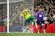 Norwich City forward Teemu Pukki (22)  tries to lift the ball over Blackburn Rovers goalkeeper Jayson Leutwiler (13) during the EFL Sky Bet Championship match between Norwich City and Blackburn Rovers at Carrow Road, Norwich, England on 27 April 2019.