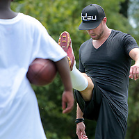Connor Barth demonstrates place kicking Sunday July 13, 2014 during a kicking clinic at Hoggard High School in Wilmington, N.C. (Jason A. Frizzelle)
