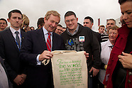 Enda Kenny with a Shopping bag with a Bible verse on it at the ploughing.