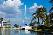 Luxury catamaran yacht sailing into port at upmarket South Seas Island Resort on Captiva Island in Florida, USA