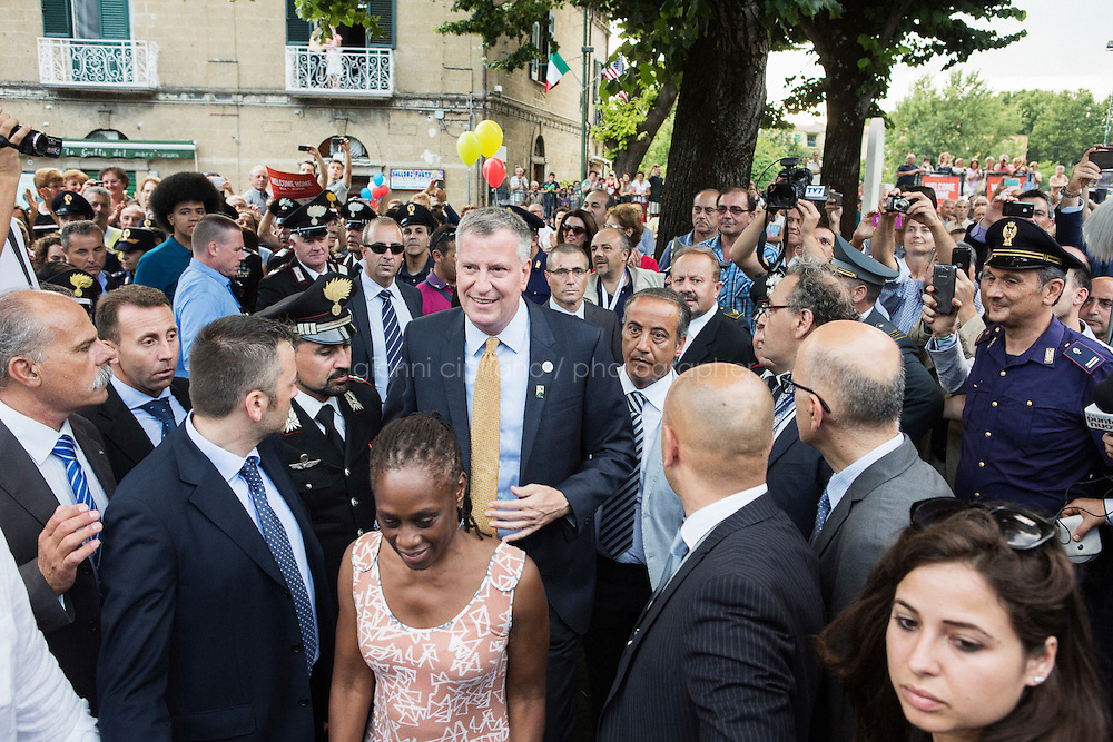 SANT'AGATA DE GOTI, ITALY - 23 JULY 2014: Mayor of New York Bill de Blasio and First Lady Chirlane McCray, are about to walk up on stage where Mr De Blasio will receive a honorary citizenship from the mayor of  Sant'Agata de Goti his ancestral home town in Italy, on July 23rd 2014.<br /> <br /> New York City Mayor Bill de Blasio arrived in Italy with his family Sunday morning for an 8-day summer vacation that includes meetings with government officials and sightseeing in his ancestral homeland.