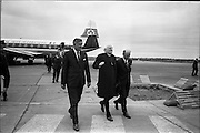 "23/06/1967<br /> 06/23/1967<br /> 23 June 1967<br /> Arrival of Dr. Michael Ramsey, Archbishop of Canterbury at Dublin Airport. Aircraft is an Aer Lingus Viscount 808 ""Gall"". Image shows (l-r): Mr. Donal Brennan, Special Sales Supervisor, Aer Lingus; Dr. Ramsey and Mr. Michael J. Dergan, General manager of Aer Lingus."