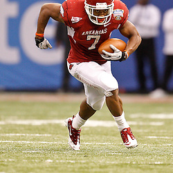 January 4, 2011; New Orleans, LA, USA;  Arkansas Razorbacks running back Knile Davis (7) runs against the Ohio State Buckeyes during the fourth quarter of the 2011 Sugar Bowl at the Louisiana Superdome.Ohio State defeated Arkansas 31-26. Mandatory Credit: Derick E. Hingle