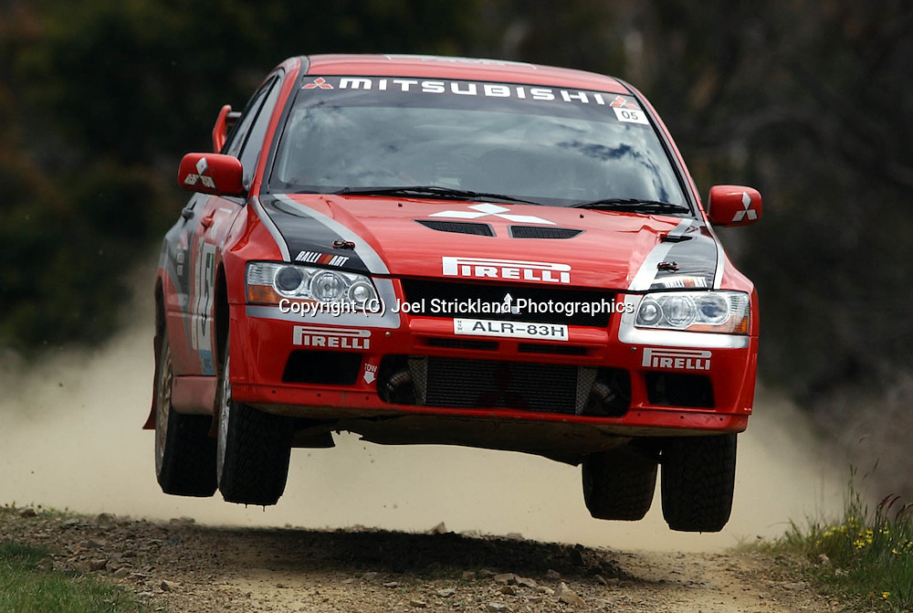 Spencer LOWNDES & Chris RANDELL.Mitsubishi Lancer Evolution VII.Motorsport-Rally.2003 NGK Rally of Melbourne.Yarra Valley, Victoria .5th of October 2003 .(C) Joel Strickland Photographics