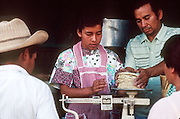 IXMIQUILPAN, HIDALGO, MEXICO: People buy traditionally made tortillas in the town of Ixmiquilpan, state of Hidalgo, in central Mexico. PHOTO © JACK KURTZ   food   women   culture  economy
