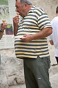 obese man eating ice cream