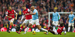 14.12.2013, Etihad Stadium, Manchester, ENG, Premier League, Manchester City vs FC Arsenal, 16. Runde, im Bild Manchester City's Vincent Kompany, action against Arsenal // during the English Premier League 16th round match between Manchester City and Arsenal FC at the Etihad Stadium in Manchester, Great Britain on 2013/12/14. EXPA Pictures © 2013, PhotoCredit: EXPA/ Propagandaphoto/ David Rawcliffe<br /> <br /> *****ATTENTION - OUT of ENG, GBR*****