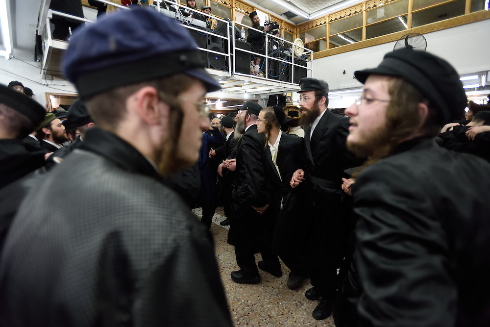 Utra-Orthodox Jewish men dance during celebrations of Purim Holiday in the Ultra-Orthodox Jewish neighbourhood of Mea Shearim in Jerusalem, on March 6, 2015. The Jewish holiday of Purim commemorates the salvation of the Jews living with in the borders of the ancient Persian Empire. Purim customs include food gifts, charity, wearing costumes and drinking heavily.