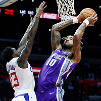 12 October 2017: Sacramento Kings center Willie Cauley-Stein (00) goes for the layup against LA Clippers guard Lou Williams (23) during the LA Clippers 104-87 victory over the Sacramento Kings, at the Staples Center, Los Angeles, California, USA.
