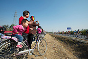 Locals watch the 2011 Tour of Beijing Stage 2
