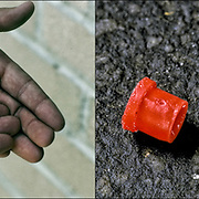 Left: Dealer holding dime bags of crack and coke.<br />
