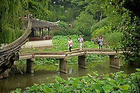 Visitors to the Humble Administrator's Garden cross over the Small Flying Rainbow Bridge.