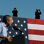 Counter snipers keep an eye from a roof top as President Bush attends an event Thursday, Sept. 16, 2004, in St. Cloud, MN...Photo by Khue Bui