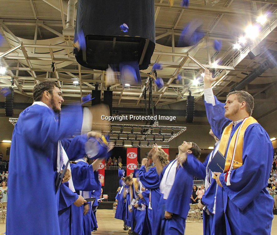 Tremont graduates toss their hats skyward following their graduation ceremony.