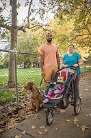 """If I could change one thing in the world...I would rather see people willing to listen than and less willing to act.""   -Ian Brooks with his wife, Megan,  one year old daughter, Remy, and rescue dog, Bowie, on Cedar Street in Calistoga."