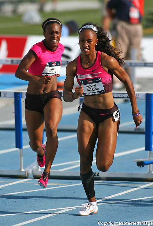 ROLLINS - 13USA, Des Moines, Ia. - Brianna Rollins stretches her lead over Kellie Wells in the finals of the 100 hurdles.  Photo by David Peterson