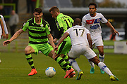 Forest Green Rovers midfielder Elliott Frear (11) and Forest Green Rovers striker Kieffer Moore (14) battle for possession 1-1 during the Vanarama National League match between Forest Green Rovers and Dagenham and Redbridge at the New Lawn, Forest Green, United Kingdom on 29 October 2016. Photo by Alan Franklin.