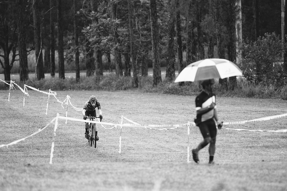A male rider stays out in front during a wet and rainy cyclocross event in Samford, Australia.
