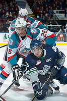 KELOWNA, CANADA -FEBRUARY 10: Colton Heffley #25 of the Kelowna Rockets checks Mathew Barzal #13 of the Seattle Thunderbirds to the ice after the face off during second period on February 10, 2014 at Prospera Place in Kelowna, British Columbia, Canada.   (Photo by Marissa Baecker/Getty Images)  *** Local Caption *** Colton Heffley; Mathew Barzal;
