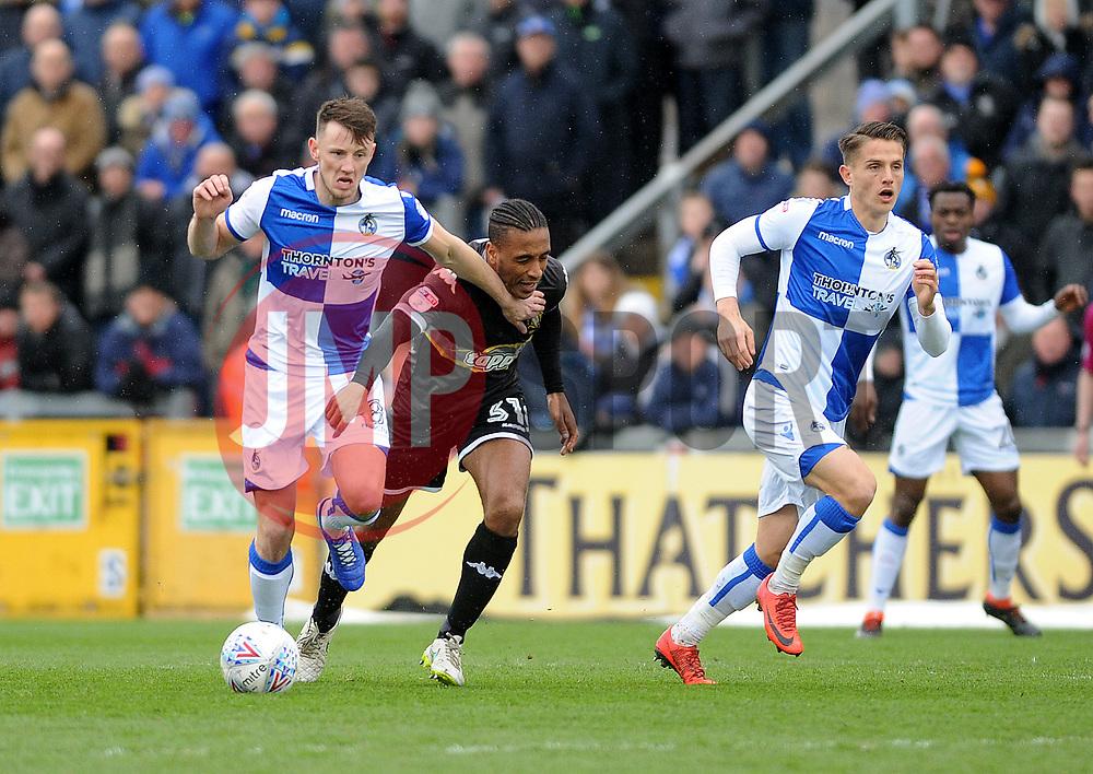 Ollie Clarke of Bristol Rovers is challenged by Neil Danns of Bury - Mandatory by-line: Neil Brookman/JMP - 30/03/2018 - FOOTBALL - Memorial Stadium - Bristol, England - Bristol Rovers v Bury - Sky Bet League One