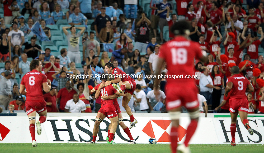 Dom Shipperly congratulated by Luke Morahan after scoring the last minute try to win<br /> Super Rugby union match, Waratahs vs Reds, Sydney, Australia. <br /> Saturday 25 February 2012. Photo: Paul Seiser/PHOTOSPORT