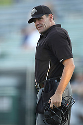 24 July 2015:  Umpire Steve Bartelstein during a Frontier League Baseball game between the Gateway Grizzlies and the Normal CornBelters at Corn Crib Stadium on the campus of Heartland Community College in Normal Illinois