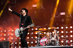 © Licensed to London News Pictures. 01/06/2013. London, UK.   Billie Joe Armstrong (left) and Tre Cool (right) of Green Day performing live at The Emirates Stadium. Green Day is an American punk rock band formed in 1987. The band consists of lead vocalist and guitarist Billie Joe Armstrong, bassist and backing vocalist Mike Dirnt, drummer Tré Cool and guitarist and backing vocalist Jason White.  Photo credit : Richard Isaac/LNP