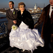 A couple weds on a bridge in Tyumen. The Siberian city enjoys a flush of cash from its oil and gas reserves.
