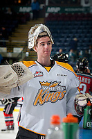 KELOWNA, CANADA - OCTOBER 25: Logan Thompson #1 of Brandon Wheat Kings stands at the bench during warm up against the Kelowna Rockets on October 25, 2014 at Prospera Place in Kelowna, British Columbia, Canada.  (Photo by Marissa Baecker/Shoot the Breeze)  *** Local Caption *** Logan Thompson;