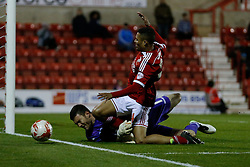 Jermaine Hylton of Swindon Town is allegedly fouled by Richard O'Donnell of Walsall and controversially awarded a penalty despite appearing to collide with the goalkeeper after losing his footing - Photo mandatory by-line: Rogan Thomson/JMP - 07966 386802 - 21/04/2015 - SPORT - FOOTBALL - Swindon, England - The County Ground - Swindon Town v Walsall - Sky Bet League 1.
