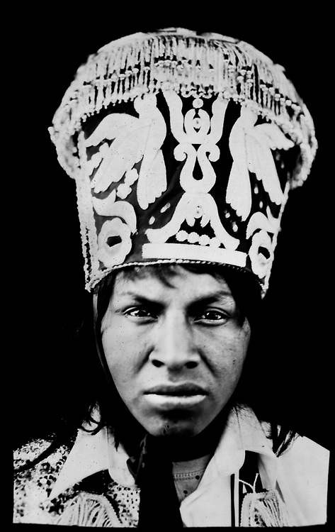 In this June 13, 2017 photo taken with a 19th century style box camera, 23-year-old Edison Olgado poses for a portrait in the Sinakara Valley, during the Qoyllur Rit'i festival. Olgado is a dancer representing the Quispicanchis nation. Tens of thousands of pilgrims crowd the Andean valley, with dancers in multi-layered skirts and musicians with drums and flutes performing non-stop over three days.