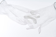 latex gloves with fingers folded in each other