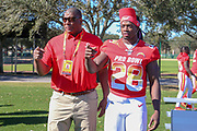 Jan 25, 2019; Kissimmee, FL, USA; Los Angeles Chargers running back Melvin Gordon lll (28) and running back coach Alfredo Roberts after the NFC team photo for the 2019 Pro Bowl at ESPN Wide World of Sports Complex. (Kim Hukari/Image of Sport)