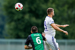 Anze Pisek of NK Rudar Velenje  and Jan Mlakar of NK Maribor during football match between NK Rudar Velenje and Maribor in 1st Round of Prva liga Telekom Slovenije 2018/19, on July 22, 2018 in Mestni stadion ob Jezeru, Velenje , Slovenia. Photo by Ziga Zupan / Sportida