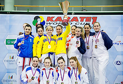 Teams of Ukraine, Croatia, Finland and Serbia celebrate at medal ceremony after Kumite Team female at Day Two of Karate 1 World Cup - Thermana Slovenia Lasko 2014 tournament, on March 16, 2014 in Arena Tri Lilije, Lasko, Slovenia. Photo by Vid Ponikvar / Sportida