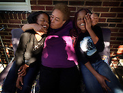 BALTIMORE --5/15/02-- Ciera and Tiera Bennett, 16, were conjoined twins at birth, but were successfully separated and are living a normal life...Ciera (left) and Tiera get a kiss from their grandmother, Laura Weeks, who is raising them...by André F. Chung